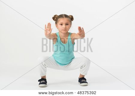 A girl is standing in a fighting stance with outstretched hands