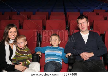 A young man with a wife and two sons in the cinema
