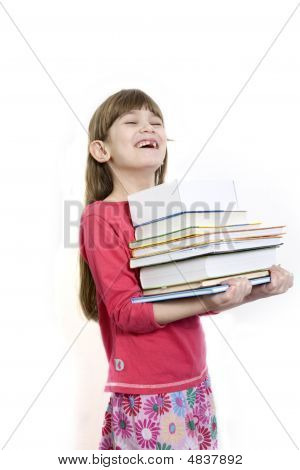 Little Cute Girl Seven Years Old Carry Books.