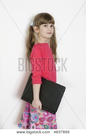 Little Cute Adorable Girl With Laptop