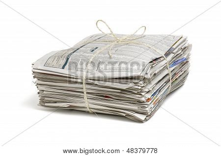 pile of newspapers on a white background