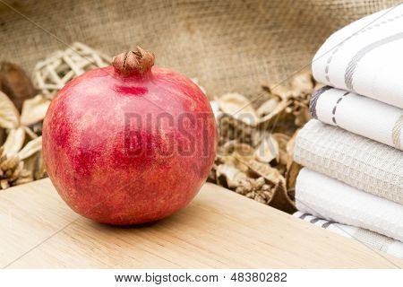 Macro Image Of Fresh Whole Pomegranite