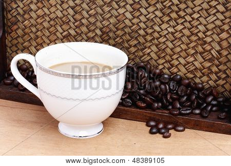 Coffee Beans With Coffee. Bamboo Background