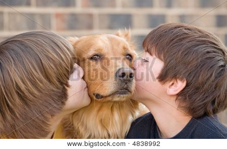 Boys Kissing A Dog