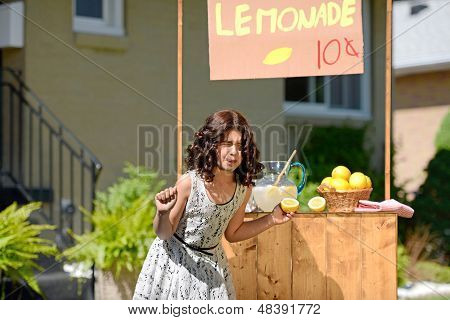 child making sour face holding lemon