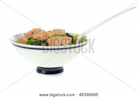Serving Of Salmon And Vegetables With Fork