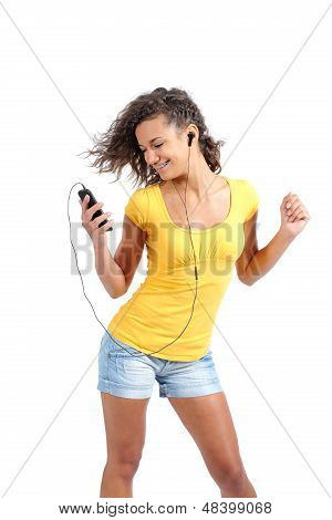 Happy Teenager Girl Dancing And Listening To The Music