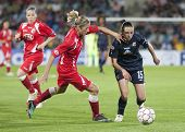 MADRID, SPAIN. 16/05/2010. Potsdam's DF Bianca Schmidt and Olympique's MF Aur�?�?�?�©lie Kaci i