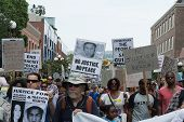 Protesters carried placards in support Trayvon and other victims of violence