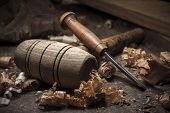 stock photo of woodcarving  - joiner tools with shavings on wood table background - JPG