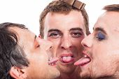 stock photo of transvestites  - Close up of three bizarre transvestites sticking out tongue isolated on white background - JPG