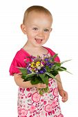 stock photo of vivacious  - Beautiful vivacious baby girl two years oldwith a posy of fresh garden flowers in her hand for her mother standing giving the camera a beautiful smile isolated on white - JPG