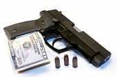 stock photo of bullet  - Big 9mm gun,  US dollars and bullets