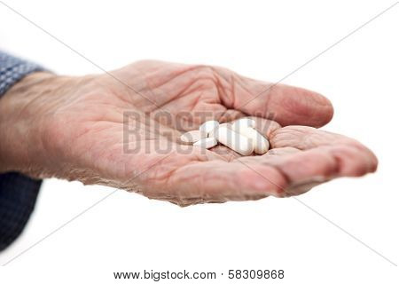 Closeup of senior hand holding medications
