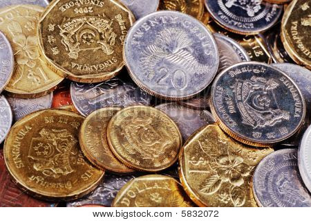 close up shot of coins in different currencies