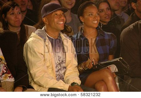 Russell Simmons and Eva Pigford inside at the 2006 GM TEN Fashion Show. Paramount Studios, Hollywood, CA. 02-20-07