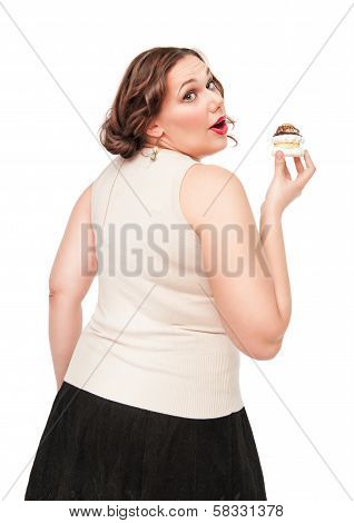 Beautiful Plus Size Woman Eating Pastry