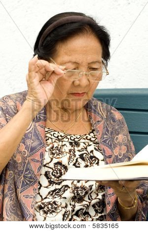 Elderly Woman read book