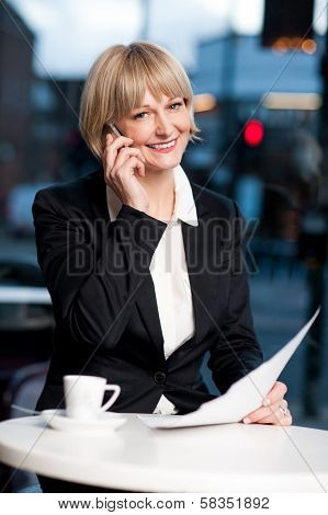 Manager Communicating Via Cell Phone In Cafe