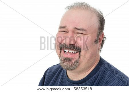 Portrait Of A Funny Mature Man Laughing