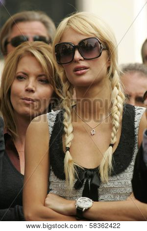 Jeanie Buss and Paris Hilton at the Ceremony Honoring Los Angeles Lakers Owner Jerry Buss with the 2,323rd star on the Hollywood Walk of Fame. Hollywood Boulevard, Hollywood, CA. 10-30-06