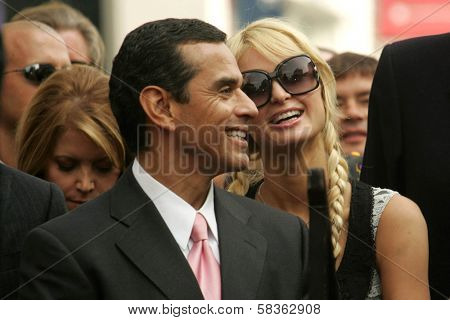 Antonio Villaraigosa  and Paris Hilton at the Ceremony Honoring Los Angeles Lakers Owner Jerry Buss with the 2,323rd star on the Hollywood Walk of Fame. Hollywood Boulevard, Hollywood, CA. 10-30-06