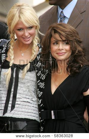 Paris Hilton and Paula Abdul at the Ceremony Honoring Los Angeles Lakers Owner Jerry Buss with the 2,323rd star on the Hollywood Walk of Fame. Hollywood Boulevard, Hollywood, CA. 10-30-06