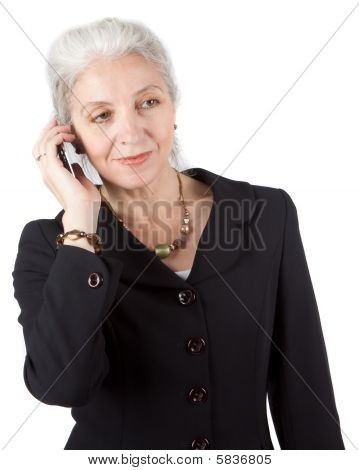 Senior Businesswoman Using Cellphone On White back