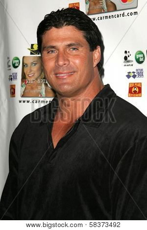Jose Canseco at the launch party for the Carmen Electra PrePaid MasterCard and the Carmen Electra Gift MasterCard. The Red Pearl Kitchen, Los Angeles, CA. 10-25-06