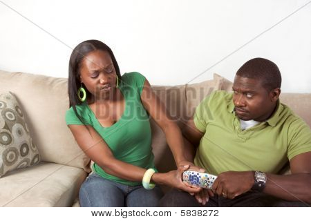 Ethnic Couple Fighting Over Tv Remote Control