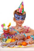 stock photo of birthday party  - little girl in party hat celebrating birthday - JPG