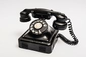 image of rotary dial telephone  - Vintage telephone with rotary dial on a white background - JPG