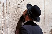 Orthodox Jewish Man prays at the western wall, Jerusalem