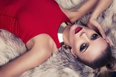 stock photo of coat  - beautiful elegant woman in red dress with fur coat - JPG