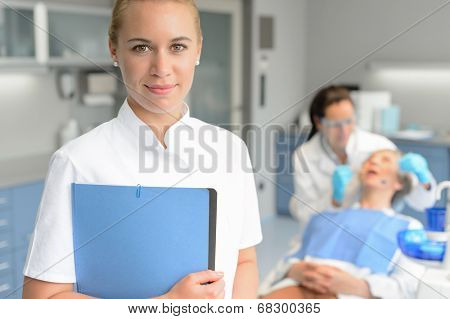 Dental assistant dentist checkup woman patient at stomatology clinic
