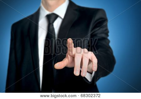 Business man pushing imaginary button