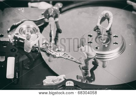 Workers Repairing Hard Disc. Macro Photo With Retro Style Effect