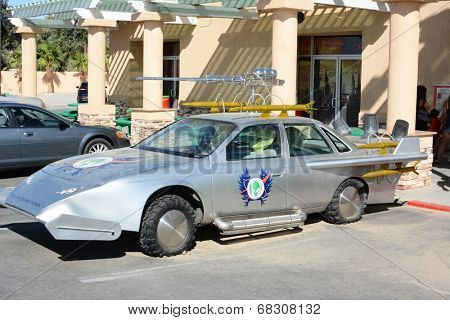 BAKER, CALIFORNIA - July 12, 2014: The Galaxy Peace Patrol vehicle in front of the Alien Fresh Jerky Store, a tourist attraction just off the I 15 Highway, the main road to Las Vegas, Nevada.