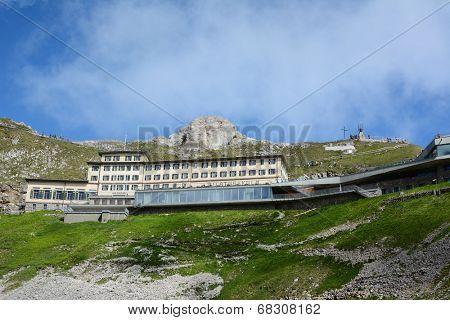 ALPNACHSTAD, SWITZERLAND - July 3, 2014: The Hotel Pilatus-Kulm, first opened in 1890, stands atop  Mount Pilatus in the Swiss Alps. Viewed from the Pilatus-Bahn cogwheel train.