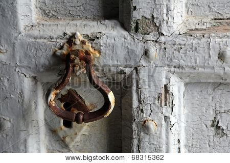 RIOMAGGIORE, ITALY - MAY 02, 2014: Detail of an ancient door of the Saint John the Baptist church in Riomaggiore, Liguria, Italy one of the Cinque Terre villages, UNESCO World Heritage Sites