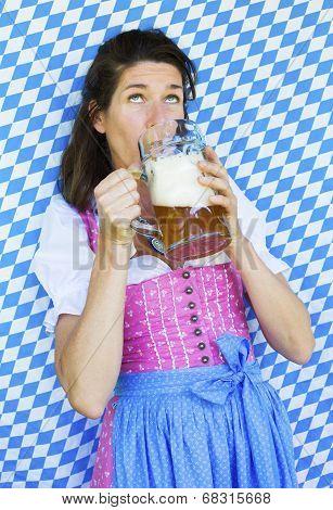 Woman In Dirndl Drinking Beer