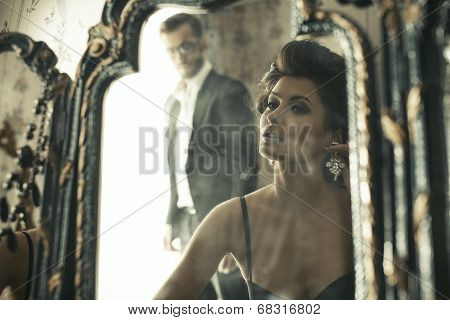 Lovely Woman Looking At Mirror Reflection.