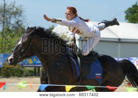 LYTKARINO, MOSCOW REGION, RUSSIA - JULY 12, 2014: Maria Kholodova performs stunt during Russian championship in trick riding. Lytkarino housed the Russian Federation of trick riding