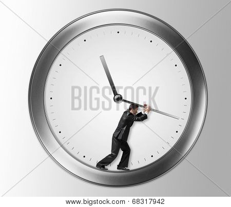 Businessman in suit with clock