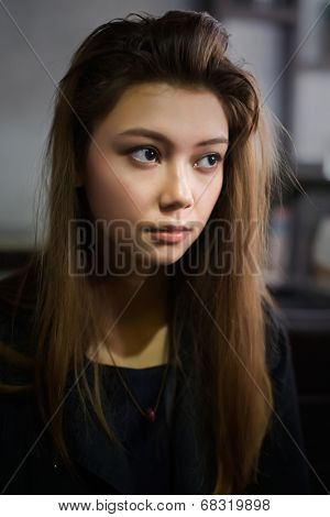 Romantic portrait of young girl with tousled hair.