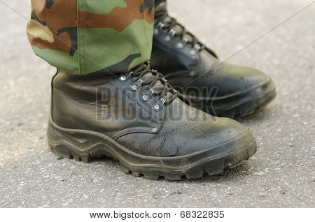Feet of soldiers in military boots and uniform