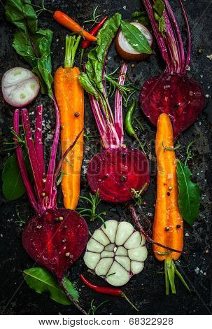 Raw vegetables for roasting, on a baking tray
