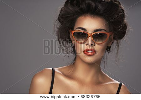 Fashion Portrait Of A Beautiful Brunette Woman With Shot Hairstyle With Orange Sunglasses - Studio P