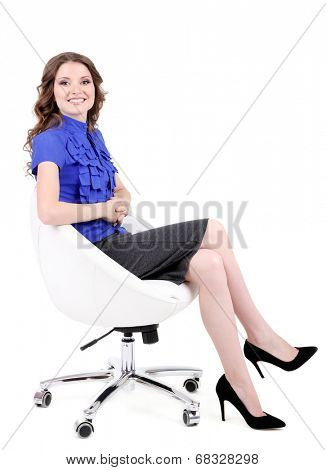 Young business woman sitting on chair isolated on white