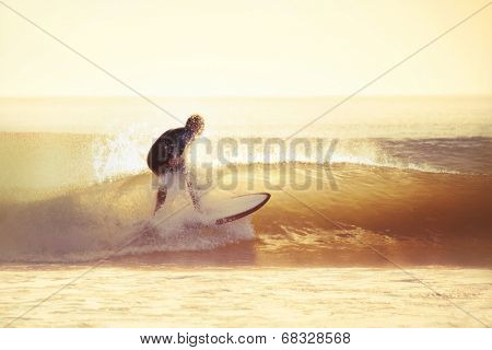 Surfing in the early morning with filter effect applied.